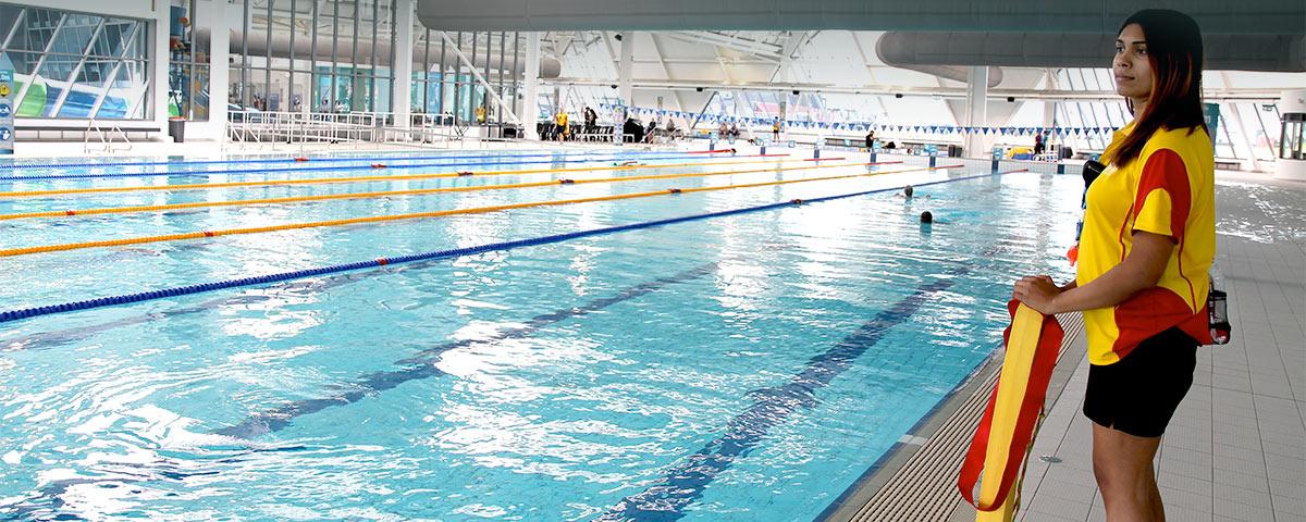 Lifeguard Bimaya Waduge watches over the 50m pool at Splash